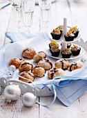 Chocolate mascarpone cream in chocolate bowls and mince pies