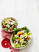 Caesar salad with avocado and an orzo salad with rocket