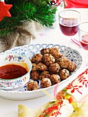 Meatballs with sesame seeds and sweet and sour sauce