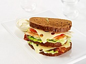 A BLT sandwich with Emmental cheese and chicken