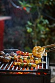 Kebabs, flatbread and meatballs on the barbecue