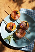 Barbecued apricots wrapped in bacon