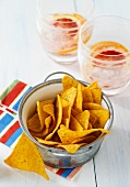 Jalapeño-flavoured tortilla chips with two drinks