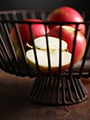 Pink Lady apples in a wire basket