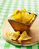 Dill flavour tortilla chips in a wooden bowl