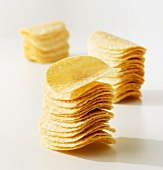Lots of potato crisps, stacked