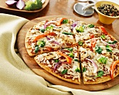 Vegetable pizza with red onions, peppers, broccoli, basil and mushrooms