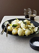 Potato salad with quail's eggs and mint