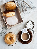 Assorted doughnuts and a cup of coffee (view from above)