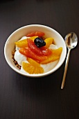 Muesli with yoghurt, oranges and pink grapefruit