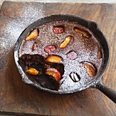 Chocolate and peach clafoutis dusted with icing sugar