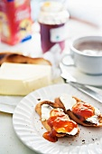Slices of toast with butter and jam, with a cup of coffee
