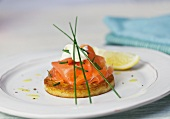 Blini with smoked salmon, sour cream and chives