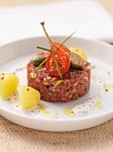 Steak tartare with cherry tomatoes and giant capers