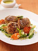 Veal meatballs with asparagus, carrots and tomatoes