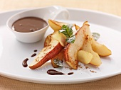 Pear wedges with chocolate sauce