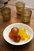 Mostarda di frutta (Italian condiment made of candied fruit and a mustard flavoured syrup) in a bowl