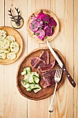 Smoked saddle of venison with potato salad, beetroot salad and cucumber