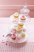 Cakes and sweet treats on a tiered cake stand