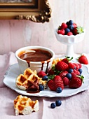 Chocolate fondue with waffles and berries