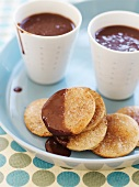 Cinnamon Tortilla Crisps Dipped in Chocolate; Cups of Melted Chocolate