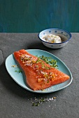 Smoked side of salmon with salt, orange zest and thyme