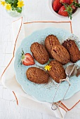 Chocolate and coconut madeleines with strawberries