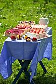 A splendid outdoor buffet of layer cakes