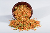 A mix of lentils and rice with herbs and spices