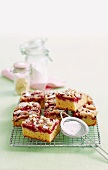 Raspberry and vanilla slices with crumble topping and icing sugar