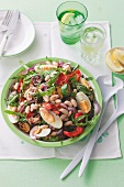 A salad of barbecued vegetables with egg