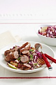 Bratwurst sausages with barbecued potatoes and red cabbage salad