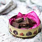 An Open Tin of Dark Chocolate Brownies with Chocolate Chunks