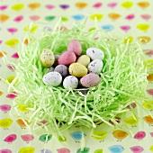 Chocolate mini eggs in a decorative nest