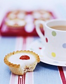 Cherry Bakewell tart with a cup of tea