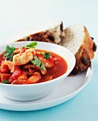 Tomato stew with prawns and seeded bread