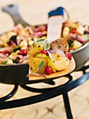 Pan-fried sausage dish with apple, cranberries, sage and croutons