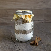 A jar containing dry ingredients for making cinnamon bread