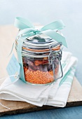 Lentil soup mix with sundried tomatoes and olives in a storage jar