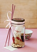 Cellophane noodles with ginger, chilli, peanuts and a small bottle of soy sauce in a screw-top jar with chopsticks