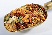 Couscous and ingredients in a scoop