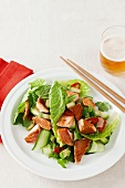 Asian-style salad with crispy salmon pieces