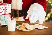 Santa claus reaching for cookie