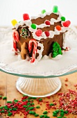 Gingerbread house on cake stand