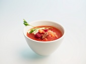 Borscht in a small bowl against a white background