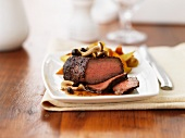 Peppered steak with berries and mushrooms