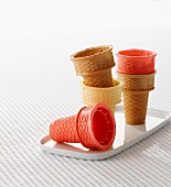 Empty ice-cream cones in assorted colours