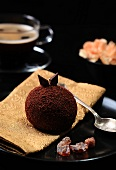 A chocolate ball and a cup of coffee