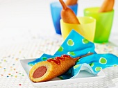 Corn dog with ketchup