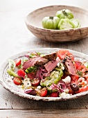 Lamb salad with tomatoes, feta and olives (Greece)